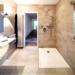 A small bathroom can be remodeled to add functionality and aesthetics by using simple renovation tricks.