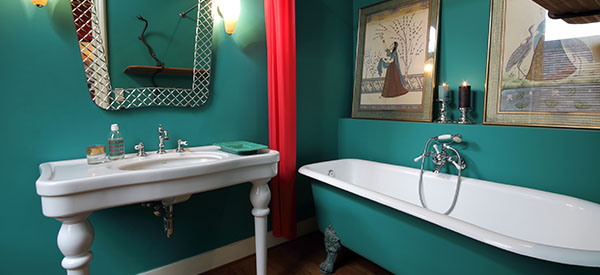 A bathroom can have a statement wall using artistic tiles as an expression of your taste and to make a corner stand out