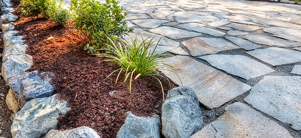 There are inexpensive materials that can be used on patio floors creatively when designed by professionals.