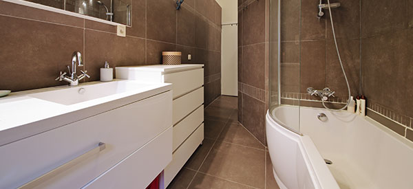 Small bathrooms can look bigger with designer tricks that are so practical.