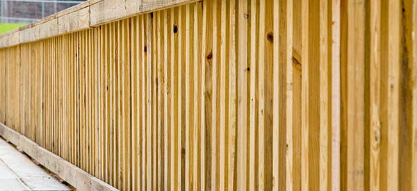 A pressure-treated fence is durable and suitable to Alberta's climate