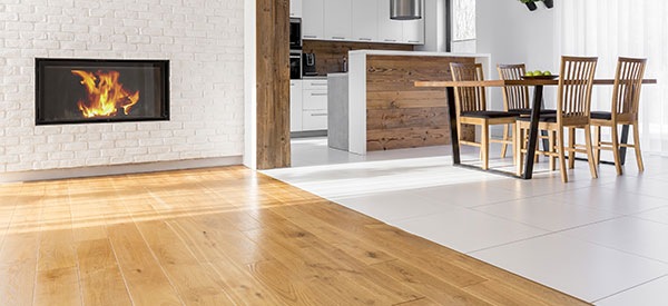 Learn the pros and cons of tile and hardwood to choose the material that is most suitable for your renovation project.