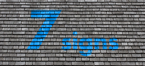 Visible signs of damage on a roof signal that it is time for a replacement.