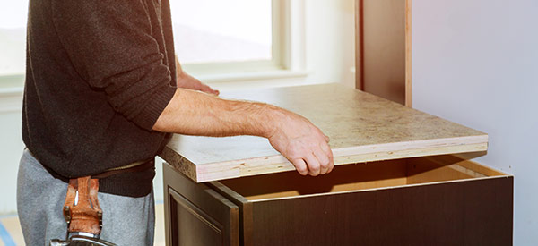 A laminate countertop is cost-effective and durable for small or large kitchens.