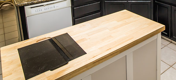 A butcher block is made of wood and costs much less than other types of countertops.