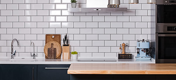 Consider a butcher block for your kitchen countertop to save money.