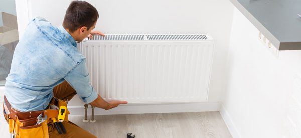 Contractor maintaining heating system in the home.