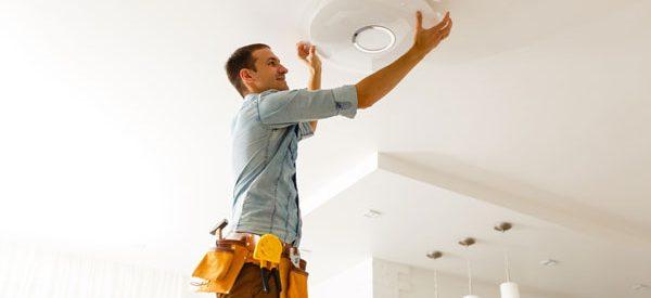Electrician-hanging-lighting-fixtures