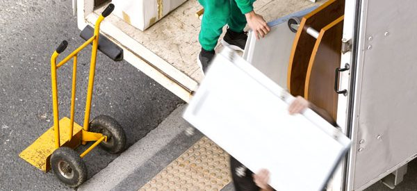 Movers-unloading-goods-at-your-destination